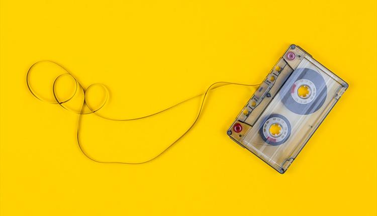Yellow background, cassette tape