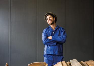 South African artist Kemang Wa  in blue outfit