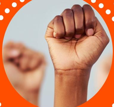 Orange frame, fist up in the air