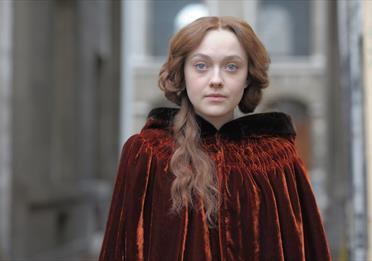 Effie Gray in brown cloak