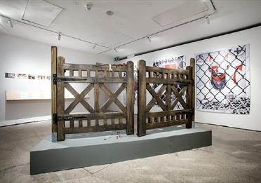 Gallery space with old wooden gates
