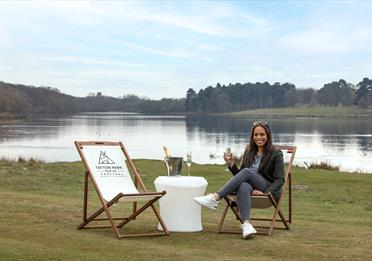 Tatton park, lake view, woman with a glass of champagne