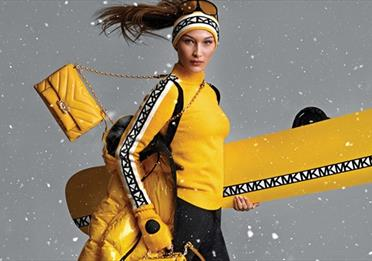 Model wearing Michael Kors ski wear and accessories.