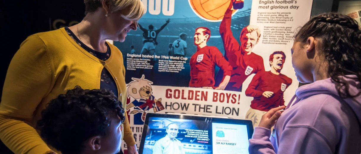 Family in an exhibition in the National Football Museum