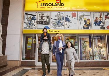 Family outside Legoland Discovery Centre