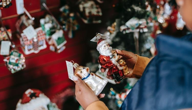 Girl choosing toys for Christmas tree