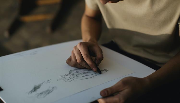 Man drawing/sketching