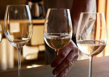 Three glasses of white wine