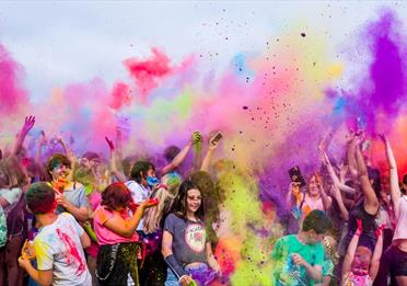 Student color run with colorful powder up in the air