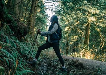 A Woman Hiking in a Forest