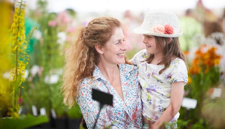 Mother and daughter in a flower show