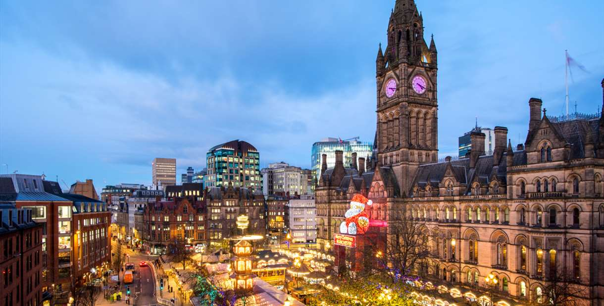 Manchester Christmas Market image of Albert Square including the stalls and 'Zippy' the giant Father Christmas that sits on Manchester Town Hall