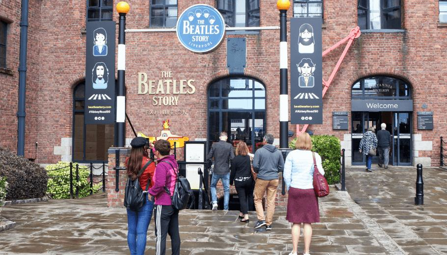 The exterior of the Beatles Story featuring a pelican crossing and yellow submarine on the iconic dock building