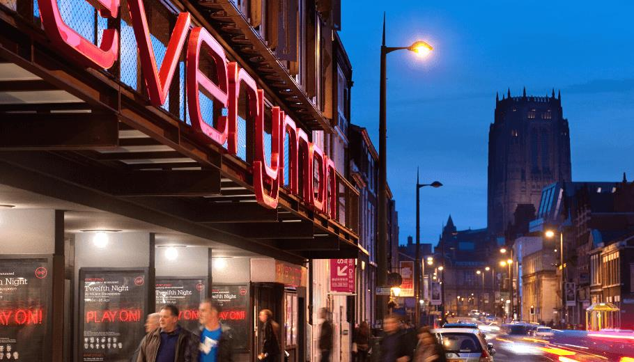 The Everyman Theatre at Night time, the Liverpool Cathedral is visible in the distance.