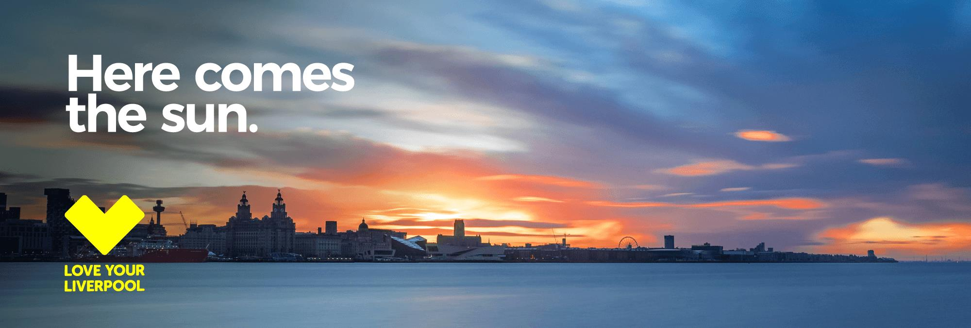 Sun rise over Liverpool skyline taken from across the river