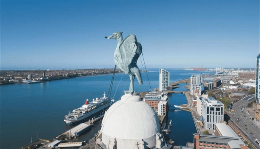 An aerial shot showing the Royal Liver Building Bird overlooking the Mersey on a sunny day.