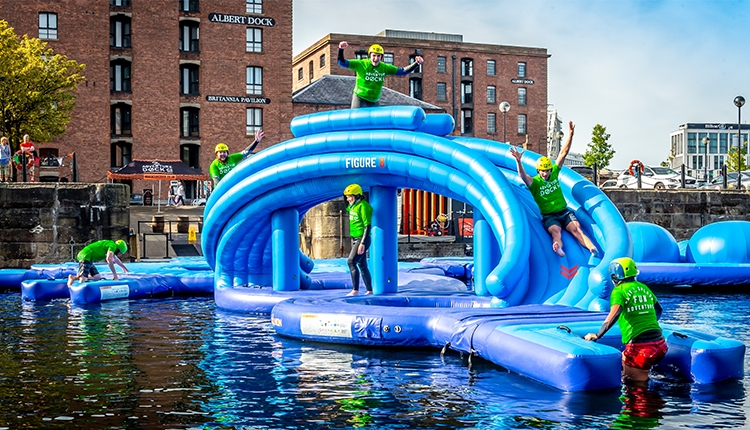 Inflatable Obstacle Course with the Royal Albert Dock in the background of the shot