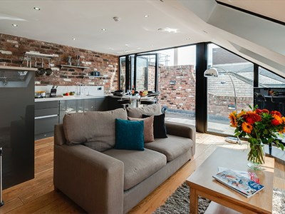 Open plan living space showing a kitchen and outdoor space