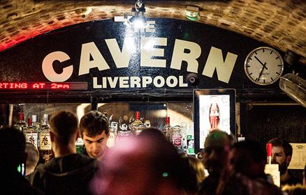 'Cavern Liverpool' in white paint above the bar