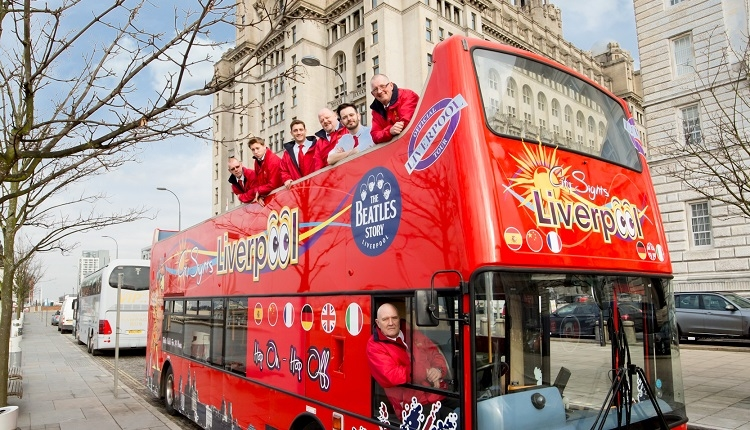 Red City Sights but with staff on the top deck outside of the Royal Liver Building