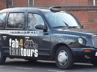 Fab 4 Taxi Tour cab on the side of the road.