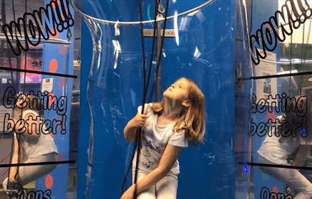 A child in a giant bubble