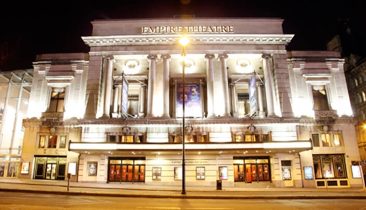 Front of the Liverpool Empire Theatre lit up with lights.