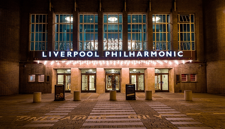 An Art Deco deco building reads 'Liverpool Philharmonic' in bright lettering