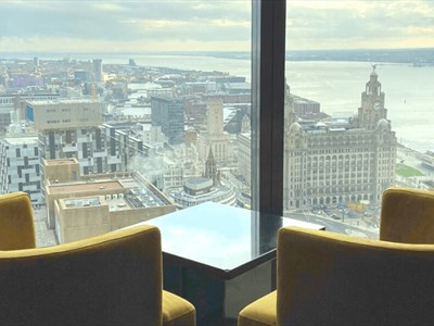 Two yellow seats are placed to look out over the city from the 34th floor, where the restaurant is situated.