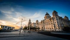 The Pier head at dusk taken with a wide angled lens. The Port of Liverpool, Edwardian Baroque building is on the right and the main focal point for th