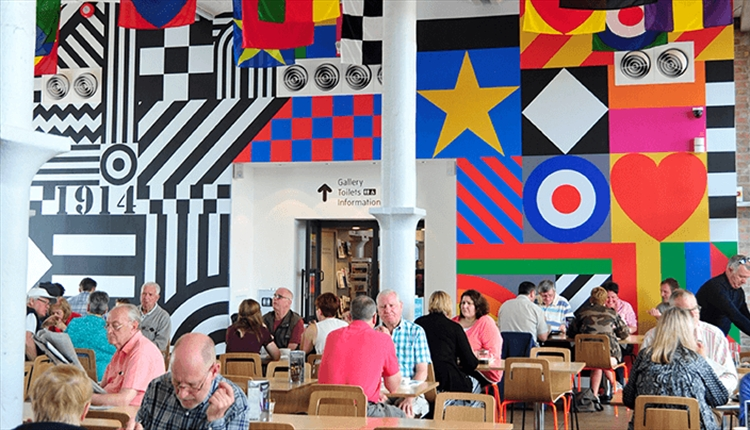 Inside Tate Cafe with a large mural on the wall