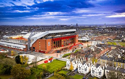 An aerial shot of the outside of Anfield Stadium.