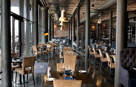 Inside the Stanleys Bar and Grill. It is a converted warehouse and the large vaulted ceilings are supporting beams are a key feature. There are huge f