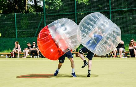 Two people in bubble armour bouncing into each other.