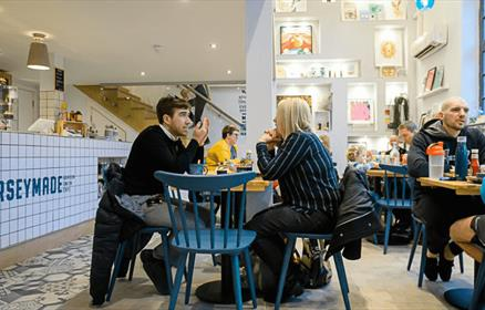 people sitting at tables in the cafe area of Merseymade