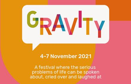 A pink and orange poster for Gravity Festival