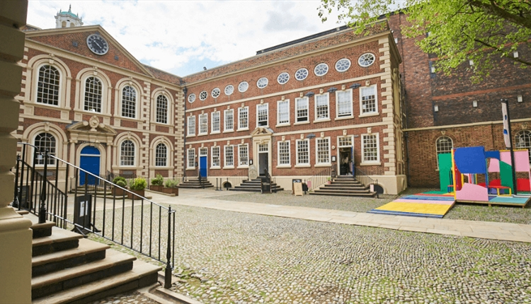 The outside of Bluecoat with their colourful platform in the right hand corner.