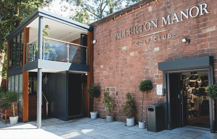 The outside front entrance of Allerton Manor with plants by the front door.