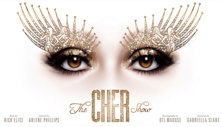 Cher's eyes with elaborate makeup on a white background.