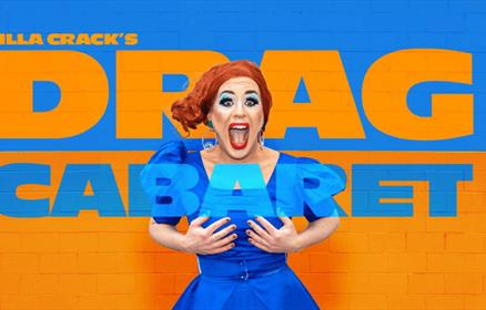 Filla Crack in a blue dress on a blue and orange background.