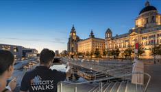 The Liverpool waterfront with people on a tour.