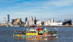 Mersey Ferry on the river with the Liverpool skyline in the background