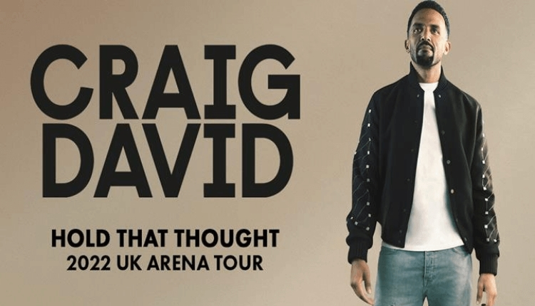 Craig David poster featuring Craig in a black jacket and jeans next to his name.