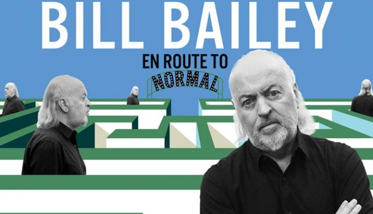 Five different photos of Bill Bailey in black and white in a green maze with a blue background.