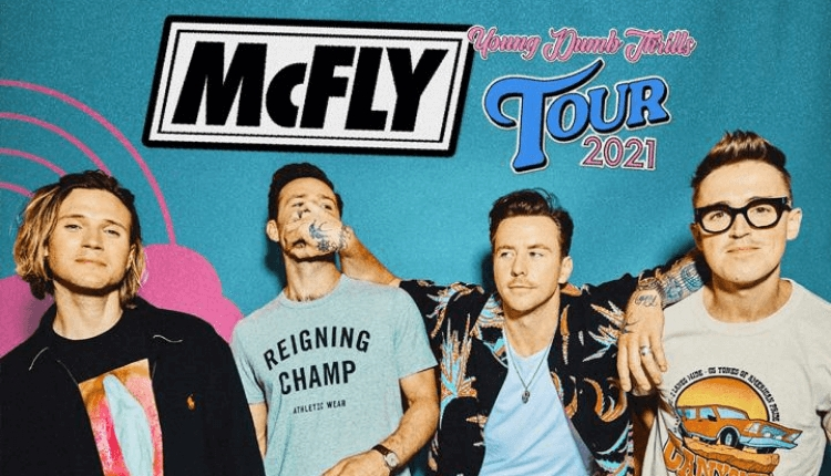 Four members of McFly with their logo.