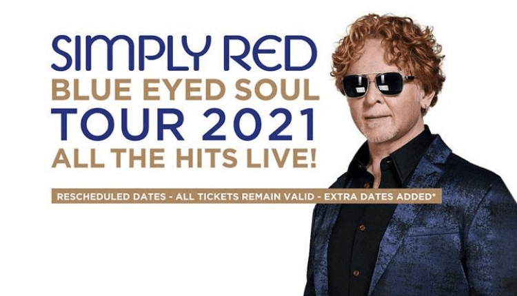 Simply red poster with the lead singer wearing a blue jacket and sunglasses.