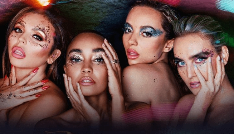The four members of Little Mix with glitter on their faces stood next to each other.