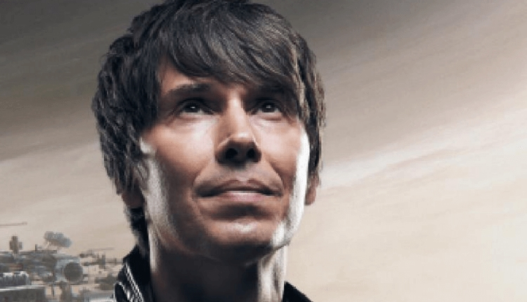 A headshot of Professor Brian Cox looking at the sky.