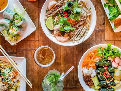 Vietnamese colourful dishes including ramen, noodles, ice teas and pine leaves