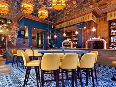 Inside Viva Brazil's large colourful bar area. The room is decorated in the traditional Brazilian colours, green and orange. It is modern and chic. Th